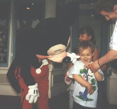 [picture of Bryan and Mickey Mouse]